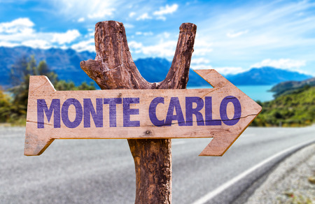 monte carlo: Monte Carlo sign with arrow on road background Stock Photo