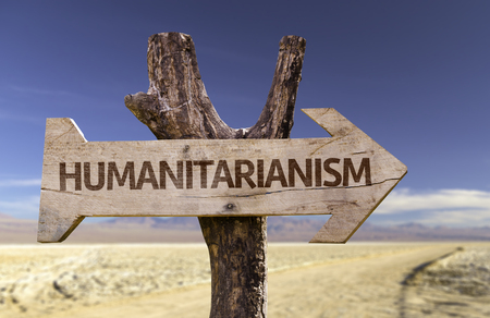 Humanitarianism sign with arrow on desert background