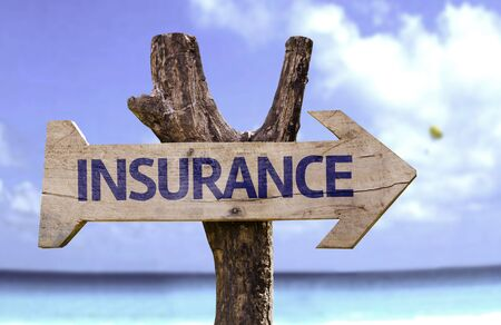 Insurance sign with arrow on beach background Stock Photo