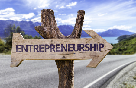 Entrepreneurship sign with arrow on road background