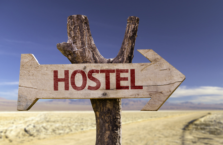 Hostel sign with arrow on desert background