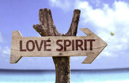 Love spirit sign with arrow on beach background Stock Photo