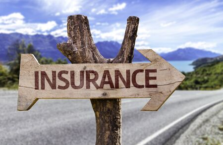 Insurance sign with arrow on road background Stock Photo