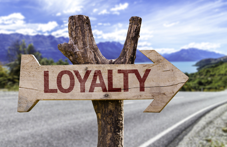Loyalty sign with arrow on road background