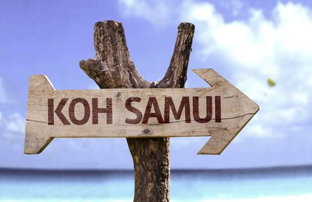 Koh Samui sign with arrow on beach background