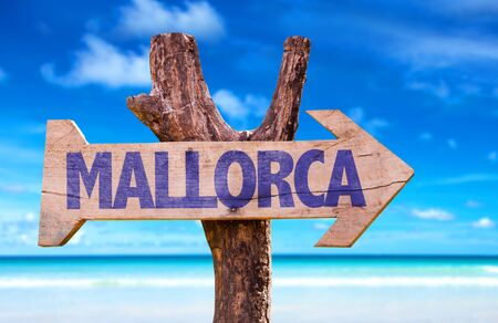 Mallorca sign with arrow on beach background Stock Photo