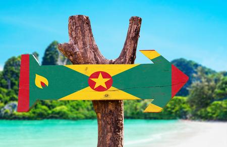 grenada: Grenada flag wooden sign board in wetland background