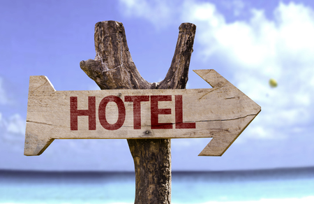 Hotel sign with arrow on beach background Stock Photo