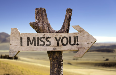 i miss you: I miss you! sign with arrow on desert background