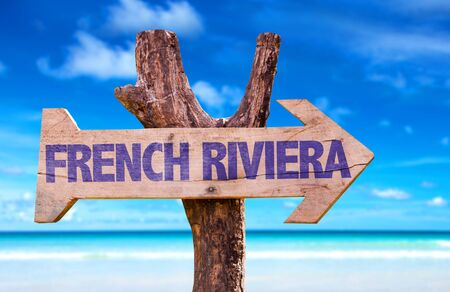cote d'azur: French Riviera sign with arrow on beach background Stock Photo