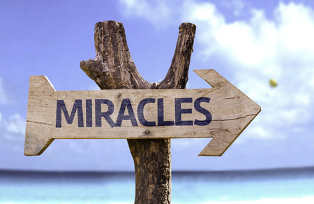 positivism: Miracles sign with arrow on beach background