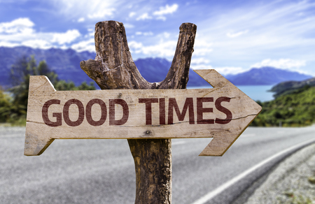 good times: Good times sign with arrow on road background