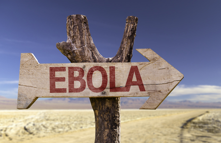 Ebola sign with arrow on desert background