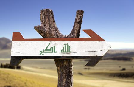 iraq flag: Iraq flag sign with arrow on desert background