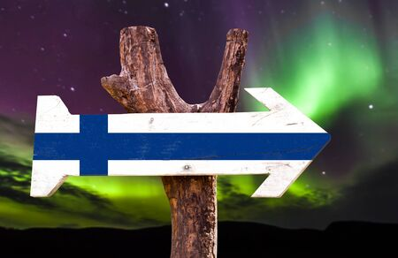finland flag: Finland flag sign with arrow on aurora borealis background