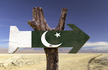 Pakistan flag sign with arrow on desert background