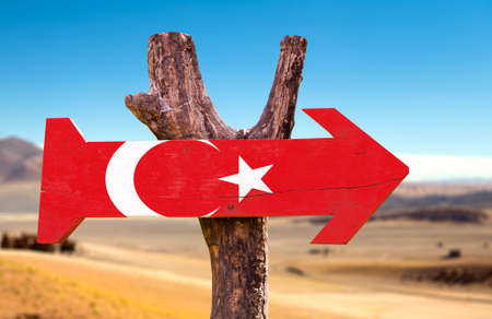 Turkey flag sign with arrow on desert background Stock Photo