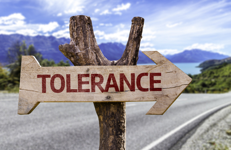 Tolerance sign with arrow on road background Stock Photo