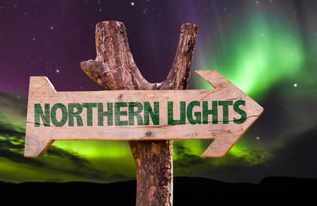 borealis: Northern lights sign with arrow on aurora borealis background