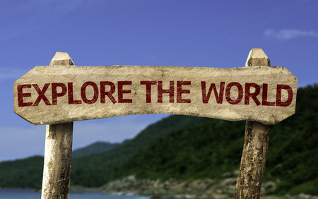 Explore the world sign with beach background