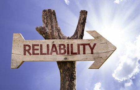 Reliability sign with arrow on sunny background Stock Photo