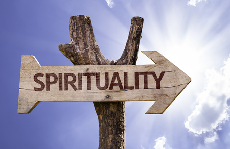equilibrium: Spirituality sign with arrow on sunny background Stock Photo