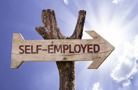 selfemployed: Self-employed sign with arrow on sunny background