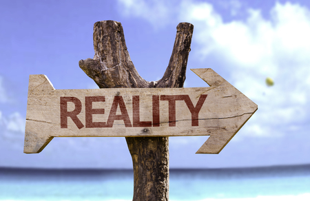 fact: Reality sign with arrow on beach background Stock Photo