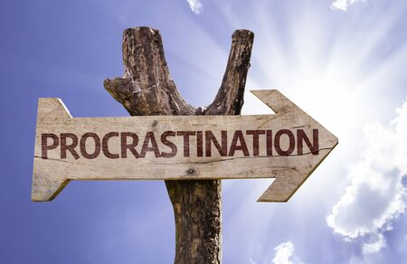 procrastination: Procrastination sign with arrow on sunny background
