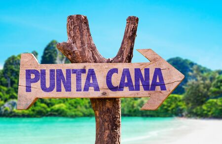 cana: Wooden sign board in wetland with text: Punta Cana