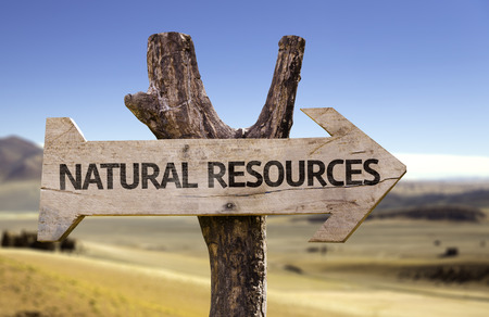 Natural resources sign with arrow on desert background Stock Photo