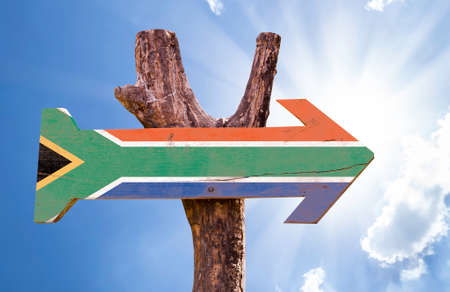 sunny south: South Africa flag sign with arrow on sunny background