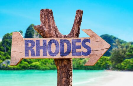 Wooden sign board in wetland with text: Rhodes Stock Photo