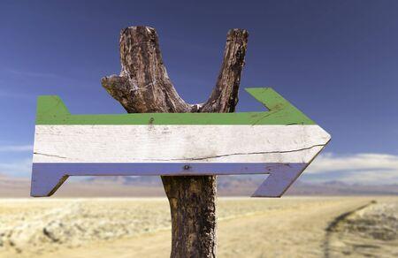 sierra leone: Sierra Leone flag sign with arrow on desert background