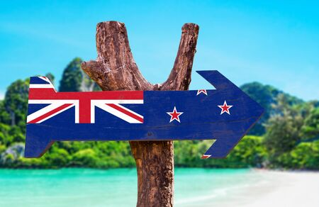 new zealand flag: New Zealand flag wooden sign board in wetland background