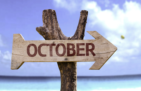 October sign with arrow on beach background Stock Photo