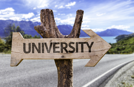 tertiary: University sign with arrow on road background