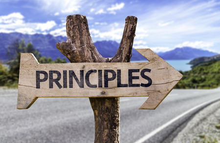 principles: Principles sign with arrow on road background