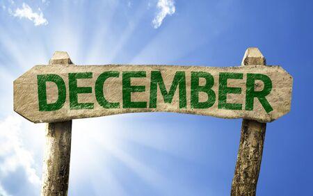 december: December sign with sunny background