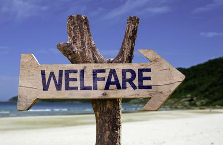 Welfare sign with arrow on beach background