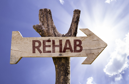 rehab: Rehab sign with arrow on sunny background