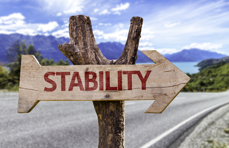 Stability sign with arrow on road background Stock Photo