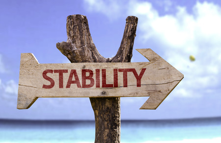 Stability sign with arrow on beach background Stock Photo