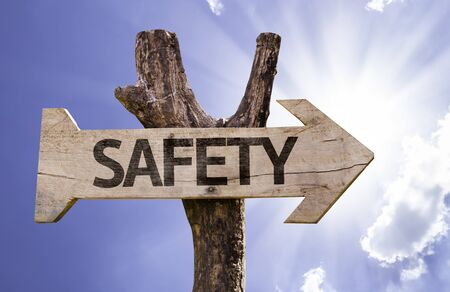 cautionary: Safety sign with arrow on sunny background