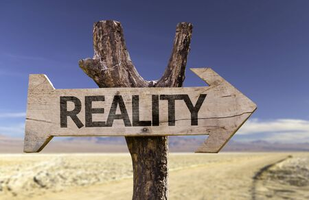 actuality: Reality sign with arrow on desert background Stock Photo