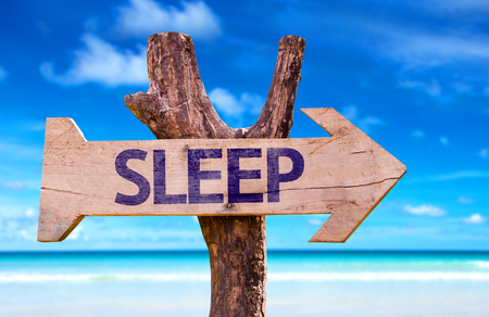 recuperate: Sleep sign with arrow on beach background Stock Photo