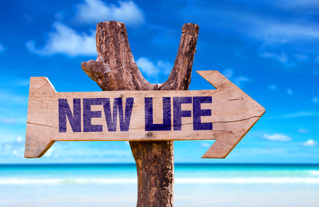New life sign with arrow on beach background