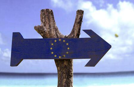 union beach: European Union flag sign with arrow on beach background Stock Photo