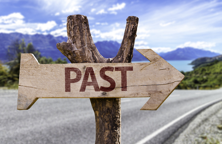 the past: Past sign with arrow on road background