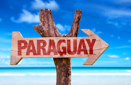 paraguay: Paraguay sign with arrow on beach background Stock Photo